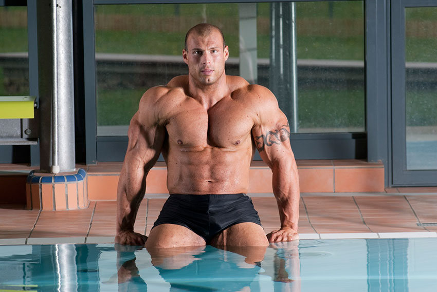 Morgan Aste sat by a swimming pool
