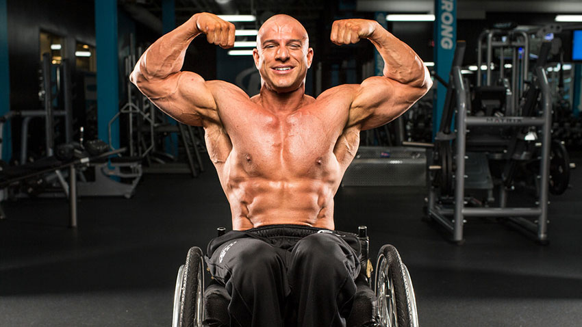 Nick Scott flexing his biceps in a photo shoot.