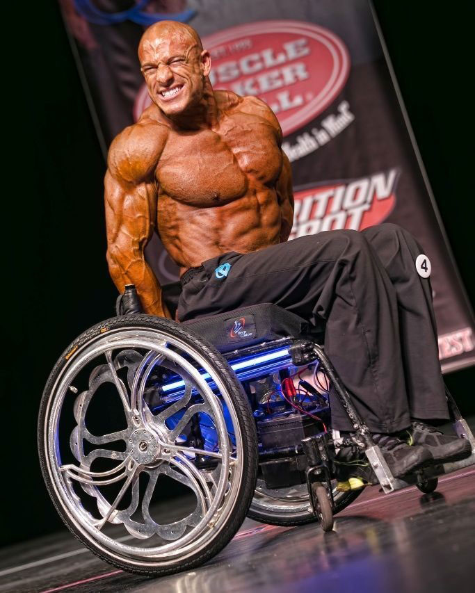 Nick Scott on stage at a bodybuilding competition.