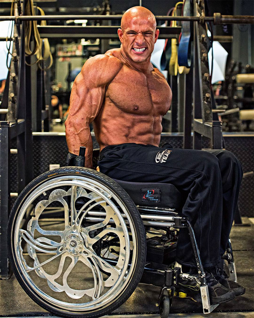 Nick Scott posing in his wheelchair.