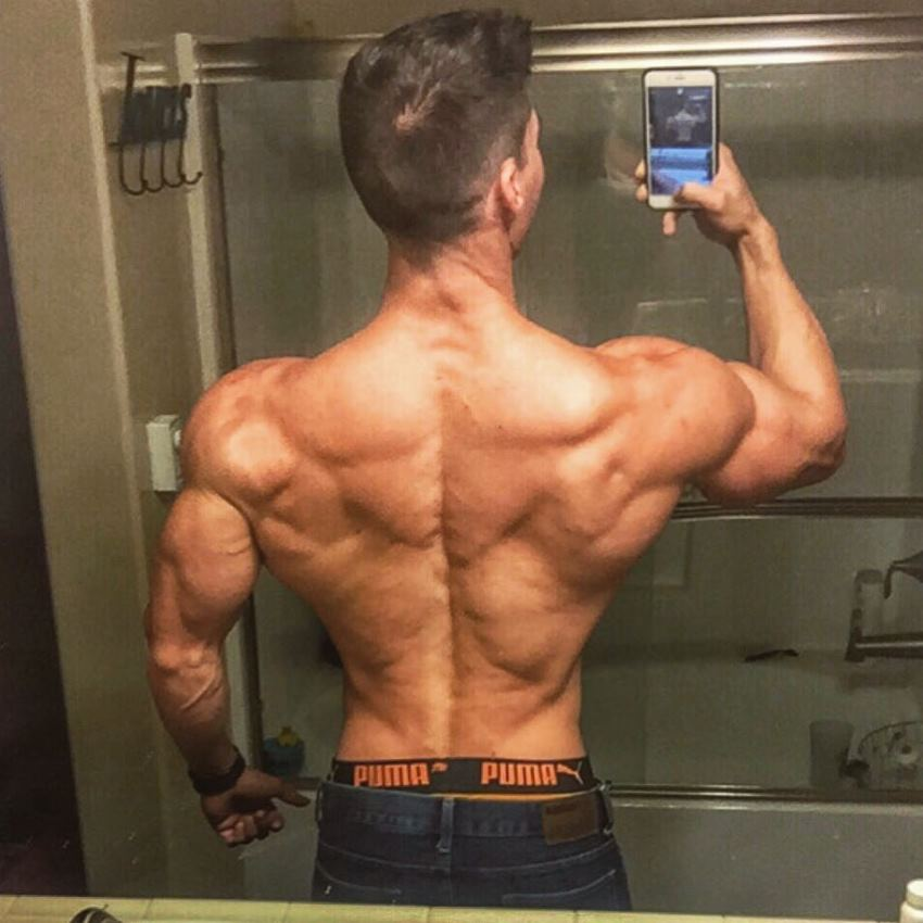 Nimai Delgado taking a selfie of his ripped back