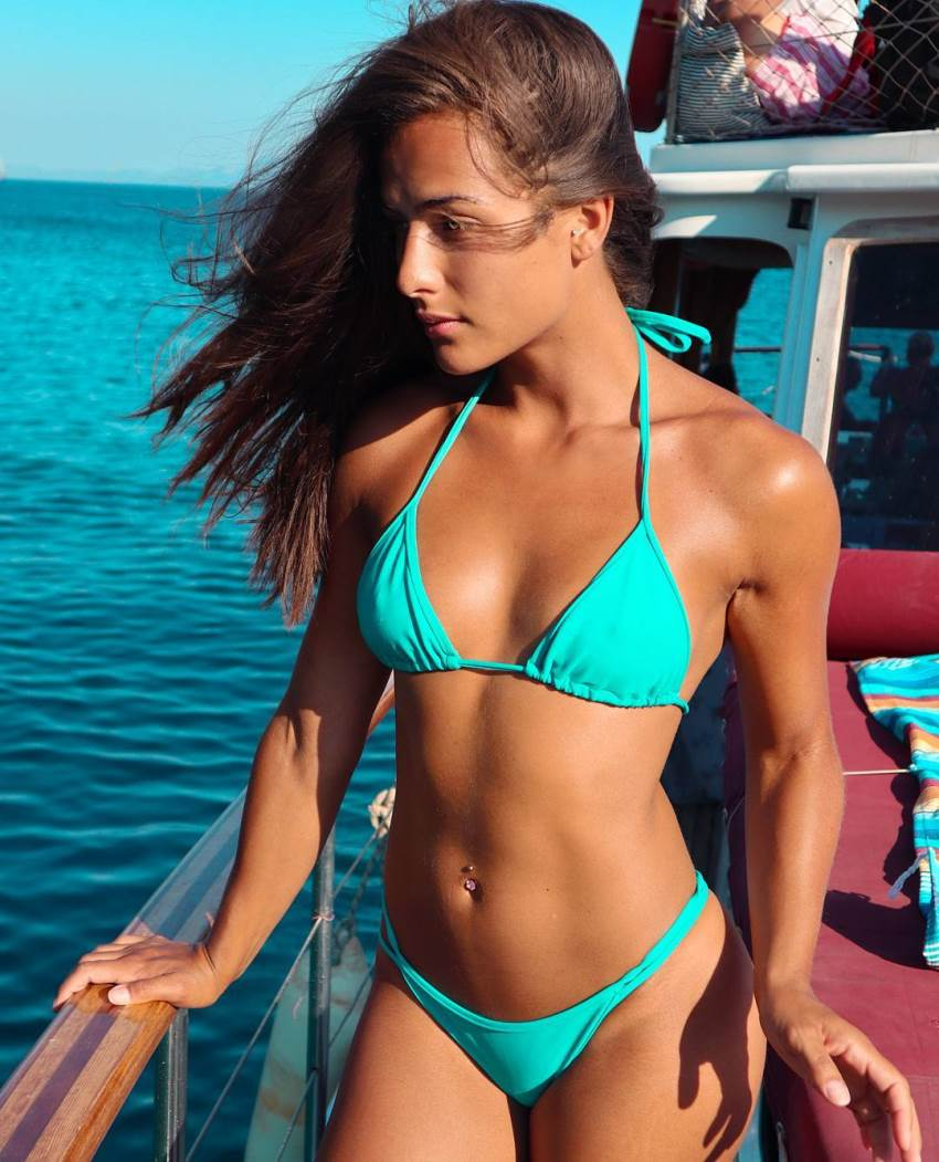 Nochtli Peralta Alvarez on the boat in a bikini looking at the sea