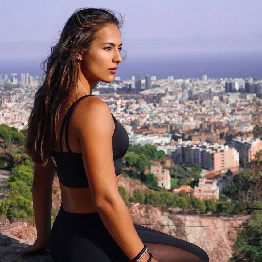 Nochtli Peralta Alvarez standing on a high viewpoint overlooking a big city