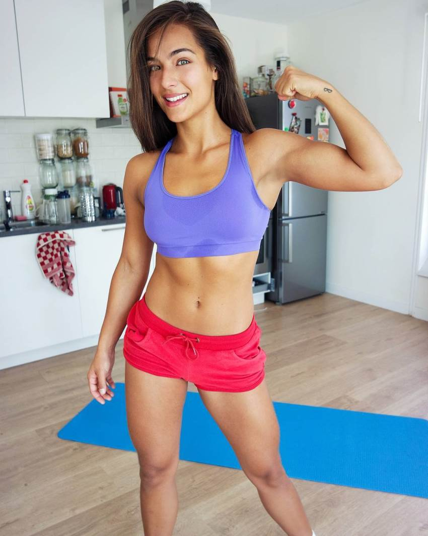 Nochtli Peralta Alvarez wearing sports clothes and flexing her biceps