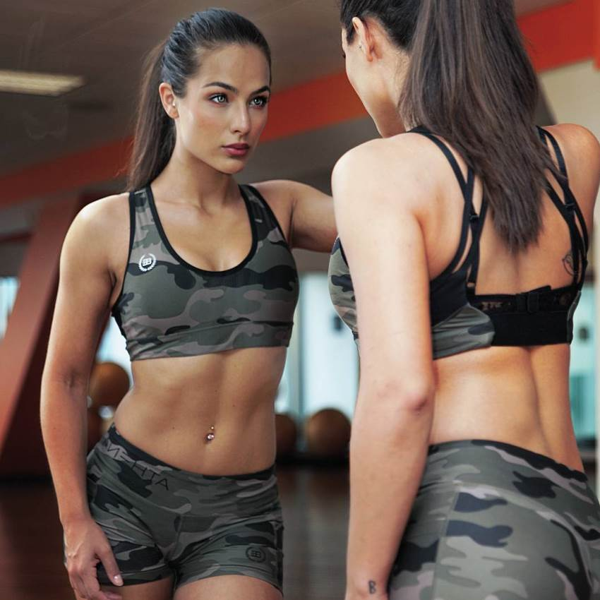 Nochtli Peralta Alvarez looking at herself in the mirror, looking fit and lean