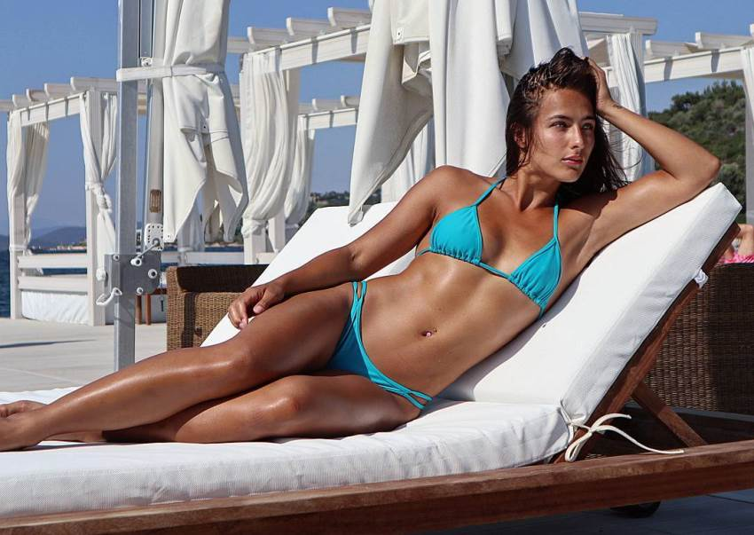 Nochtli Peralta Alvarez lying outside in a blue bikini, posing for a photo