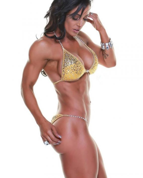 Nyssa Bovenkamp posing for a photo in the bikini, looking ripped and muscular