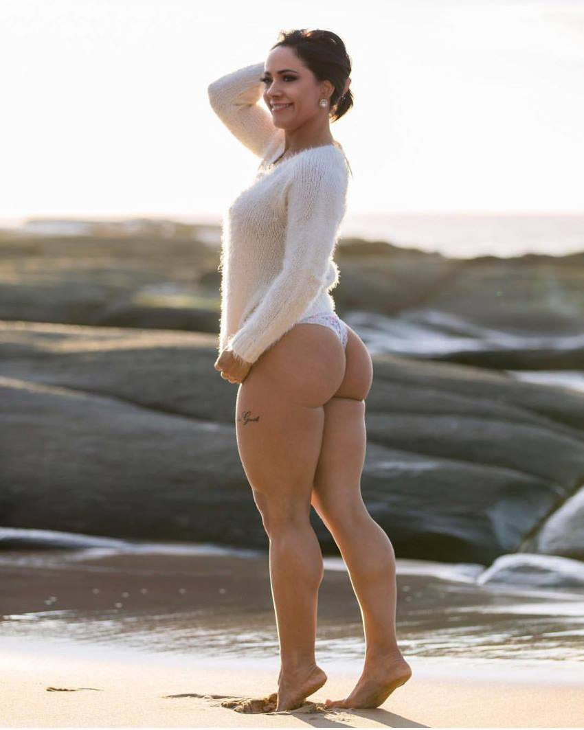 Nyssa Bovenkamp standing on the beach and showing her big glutes