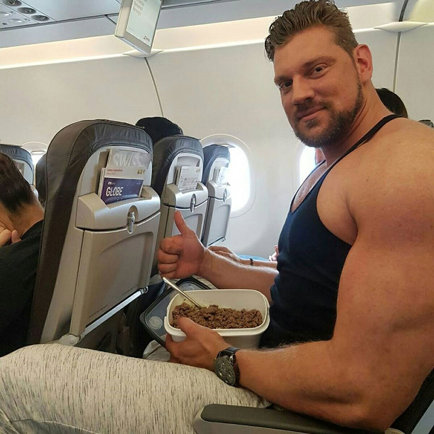 Olivier Richters sat on a plane eating a meal