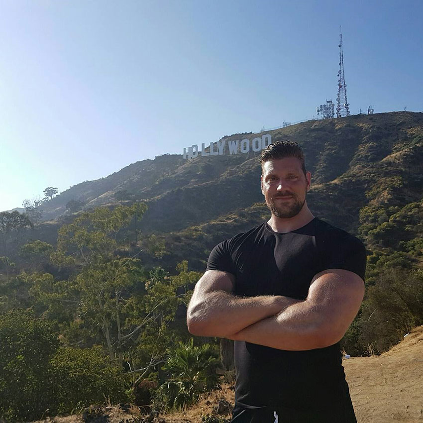 Olivier Richters standing in front of the Hollywood sign.