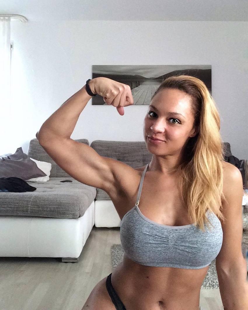 Ramona Valerie Alb flexing her biceps