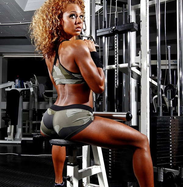 Ramona Valerie Alb seated down on a lat pulldown machine posing for the camera