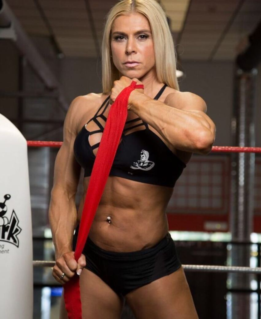 Regiane Da Silva Botthof holding a red strap looking fit and ripped