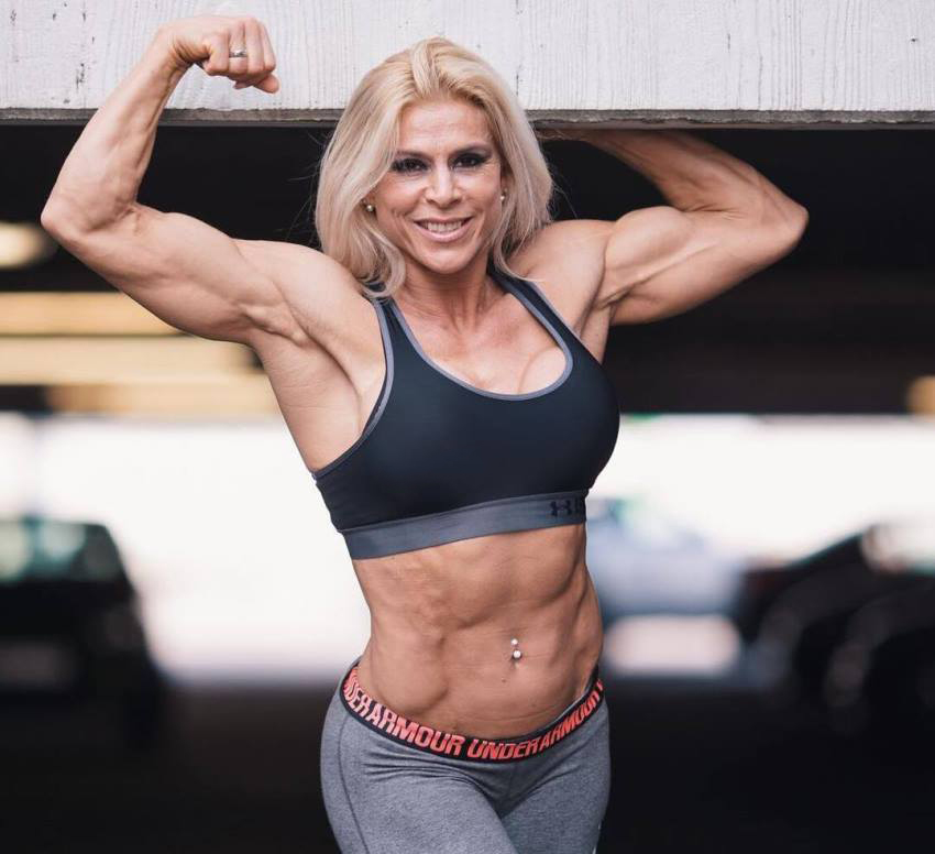 Regiane Da Silva Botthof flexing her ripped arms and abs for the camera