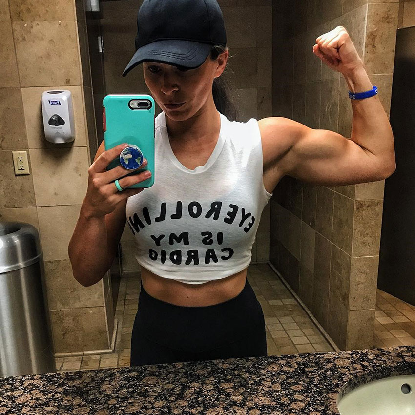 Sarah Bowmar flexing her arm taking a selfie.