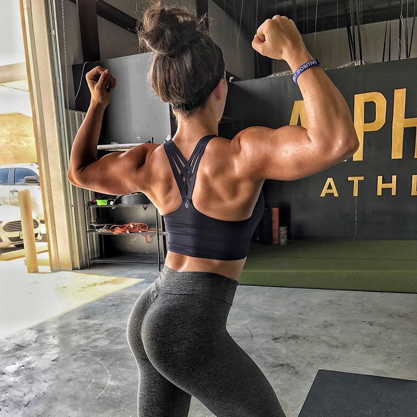 Sarah Bowmar flexing her arms showing off her back muscles.