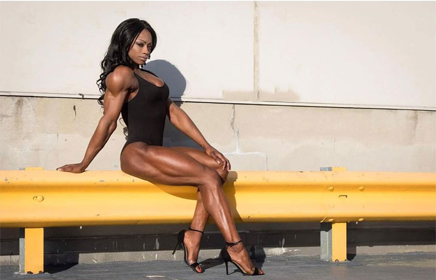 Shanique Grant sat on a rail in a photoshoot.