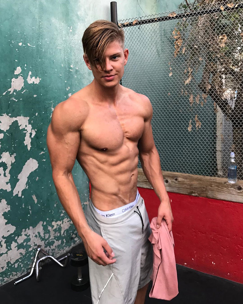 Student Aesthetics in a photo shoot showing off his physique.
