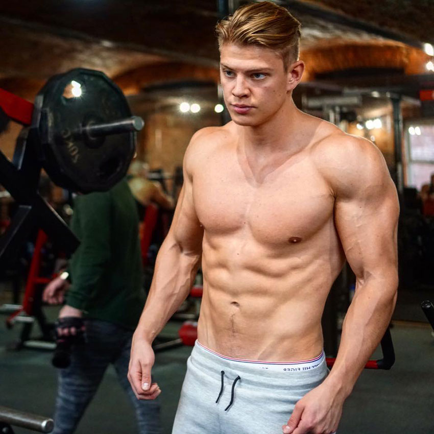 Student Aesthetics stood in the gym in a photo shoot.