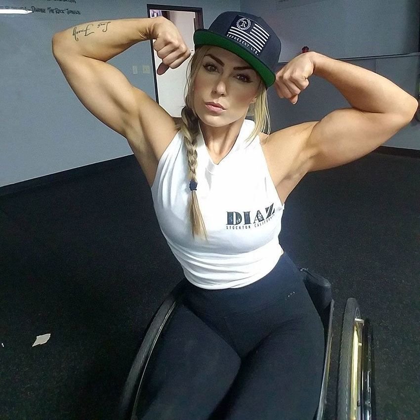 Tiphany Adams flexing her arms.