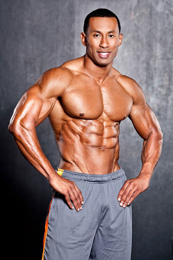 AJ Ellison showing off his physique in a photo shoot.