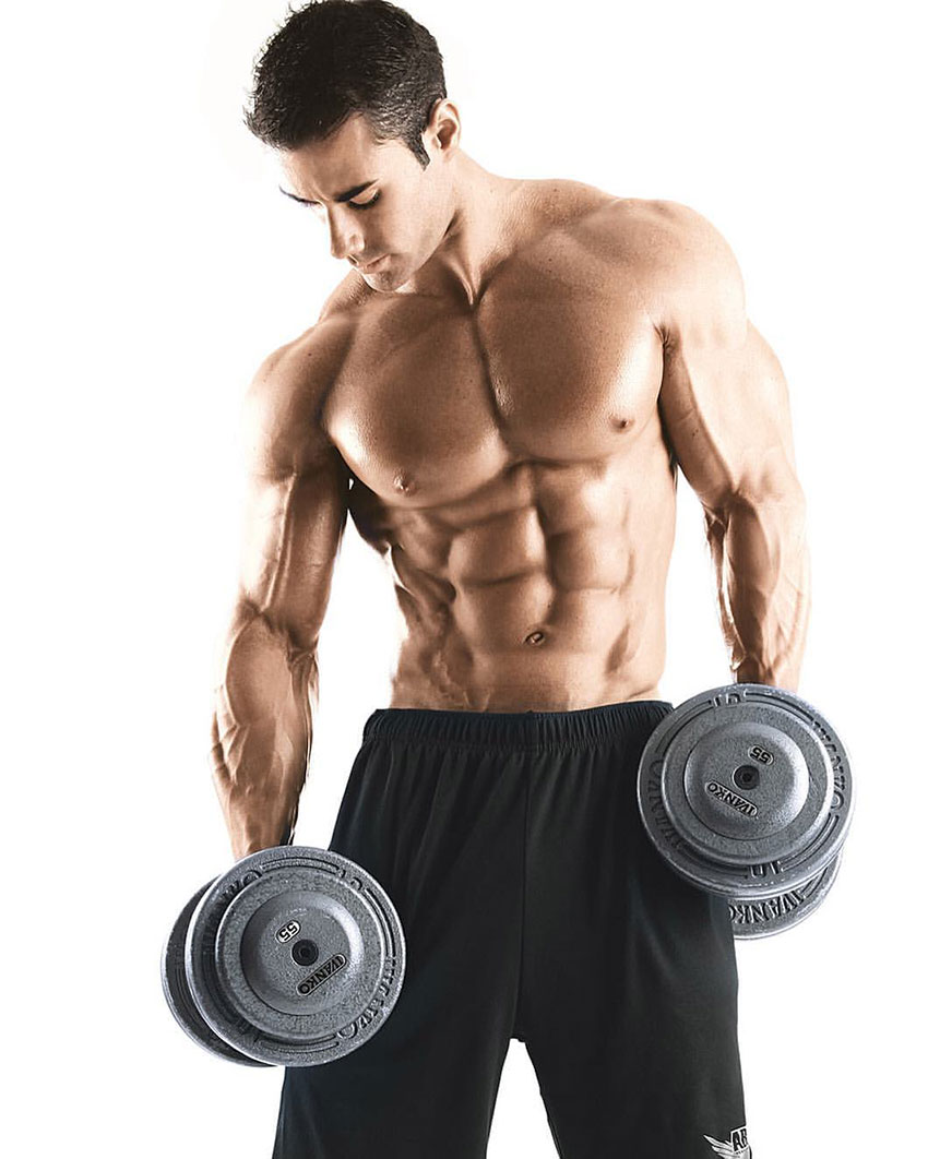 Alex Carneiro holding dumbbells in a photo shoot.