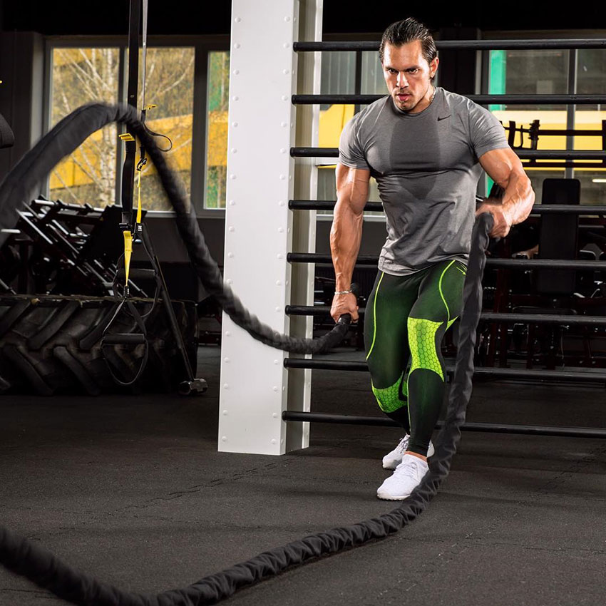 Alon Gabbay using battle ropes in the gym.