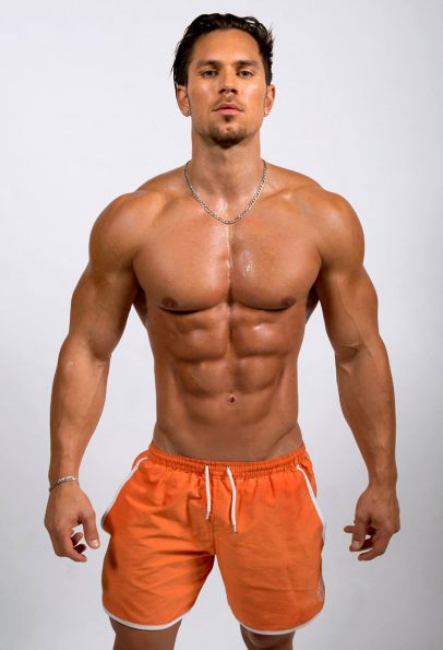 Alon Gabbay showing off his abs in a photo shoot.