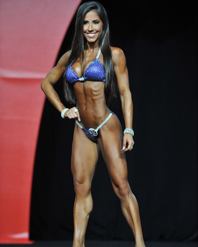 Angelica Teixeira on the bikini Olympia stage, looking ripped and fit