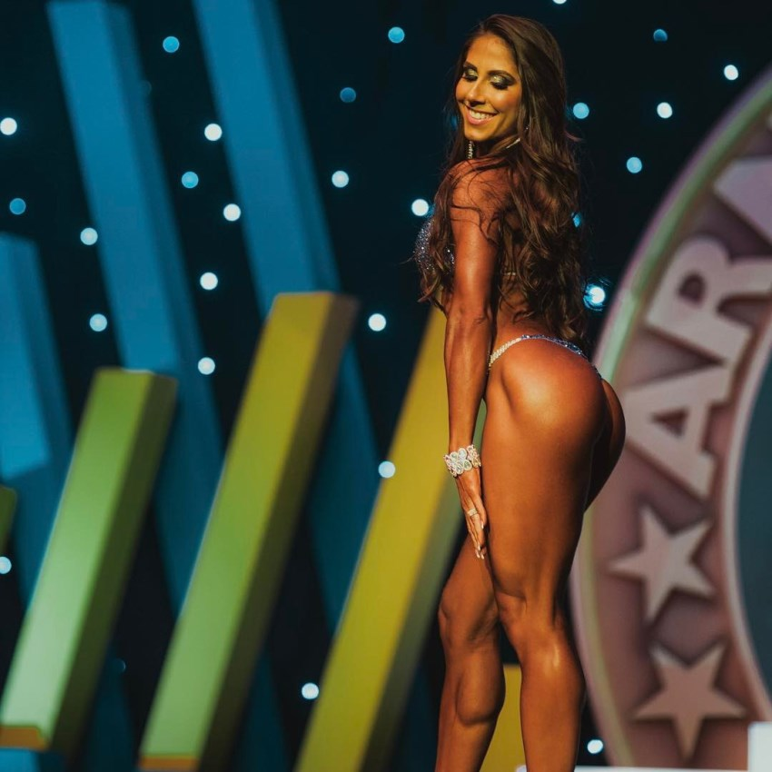 Angelica Teixeira confidently posing on the bikini stage, looking conditioned and muscular