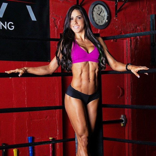 Angelica Teixeira posing in the boxing ring looking aesthetic