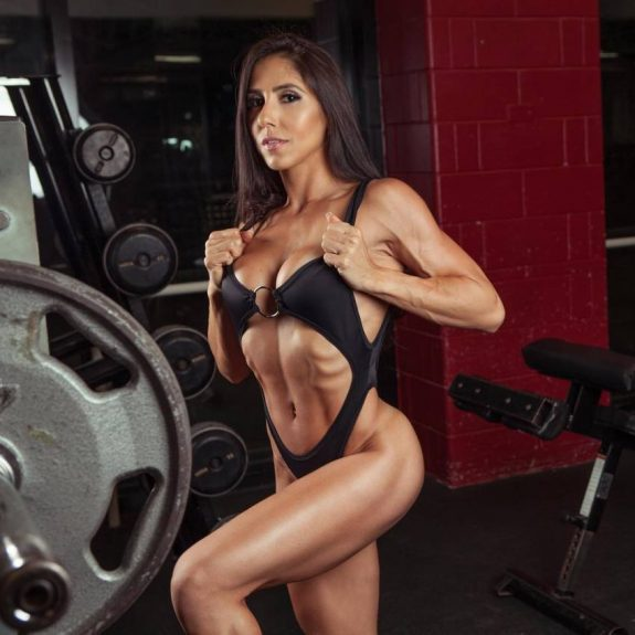 Angelica Teixeira posing for the photo in a gym, looking lean and healthy