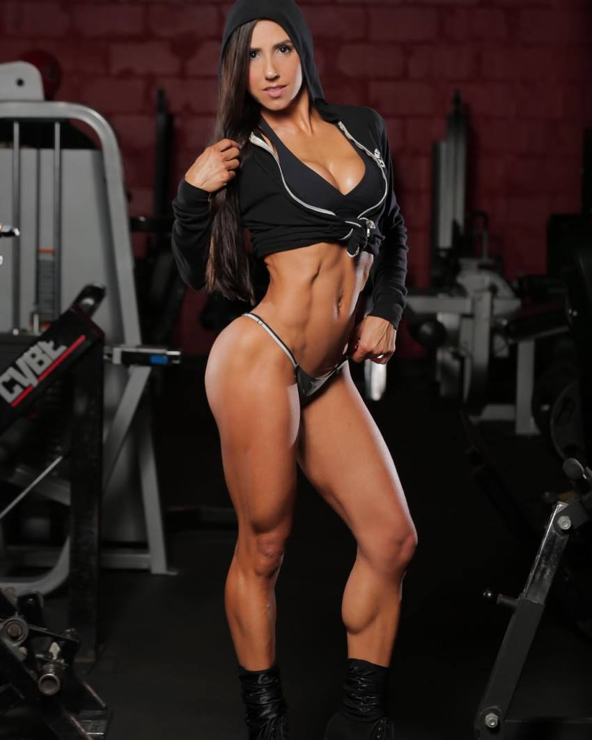 Angelica Teixeira posing for a photo, looking fit and lean