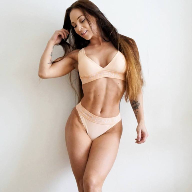 Anna Delyla posing for a photo looking fit and lean