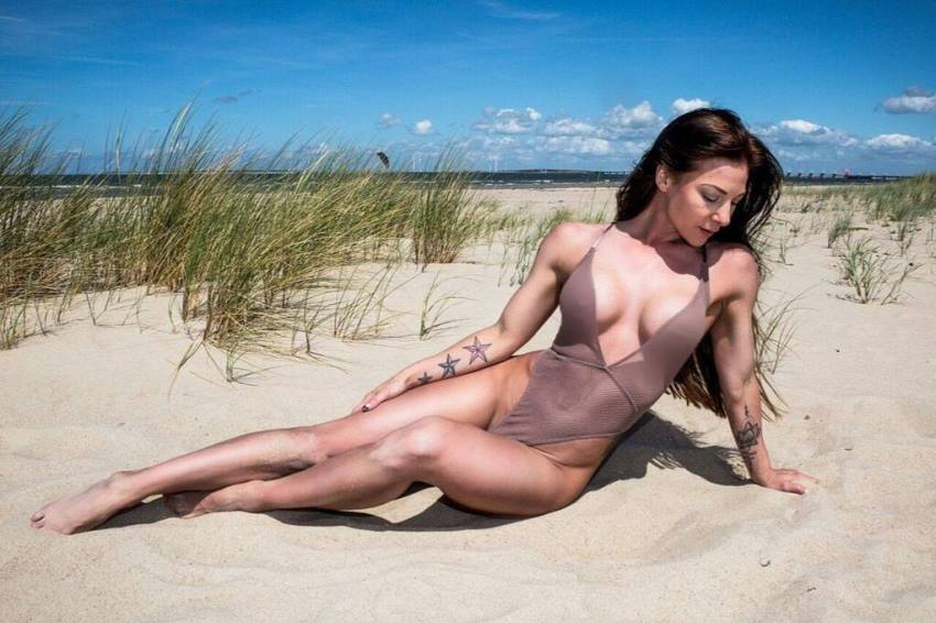 Anna Delyla lying down on the beach looking lean and healthy