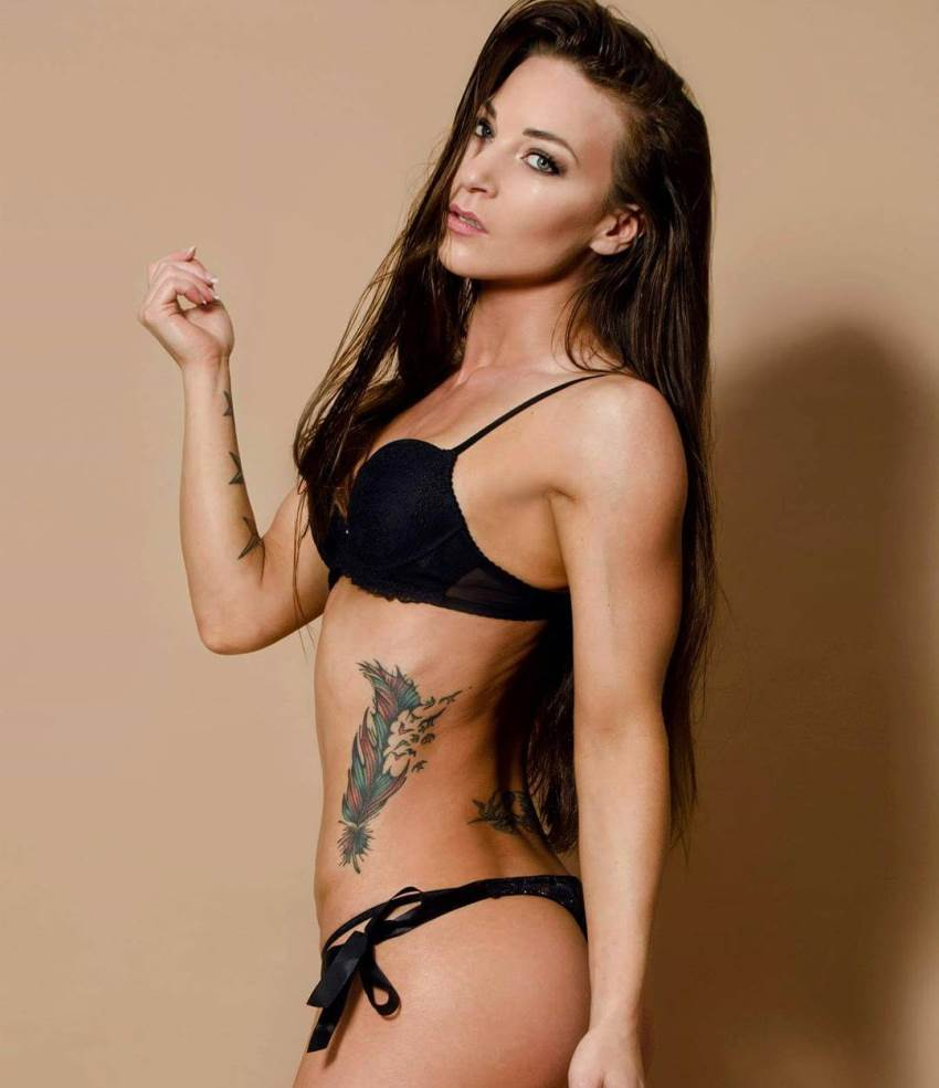 Anna Delyla posing in black lingerie looking fit