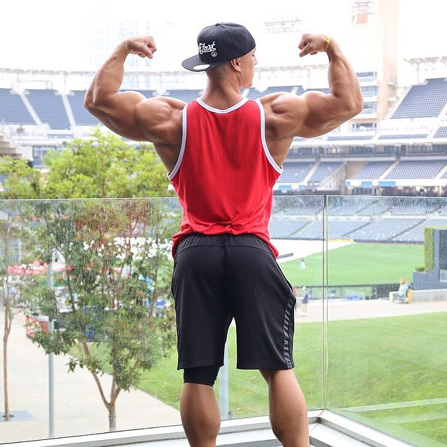 Anthony Perez flexing his biceps.