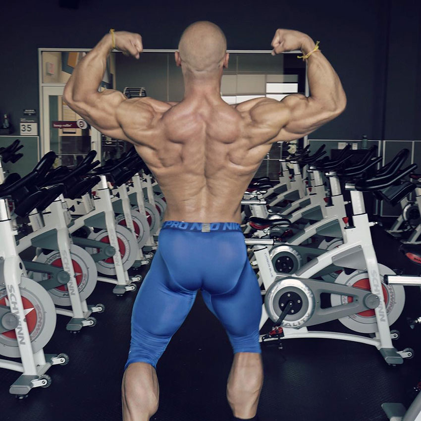 Anthony Perez flexing showing off his back muscles.