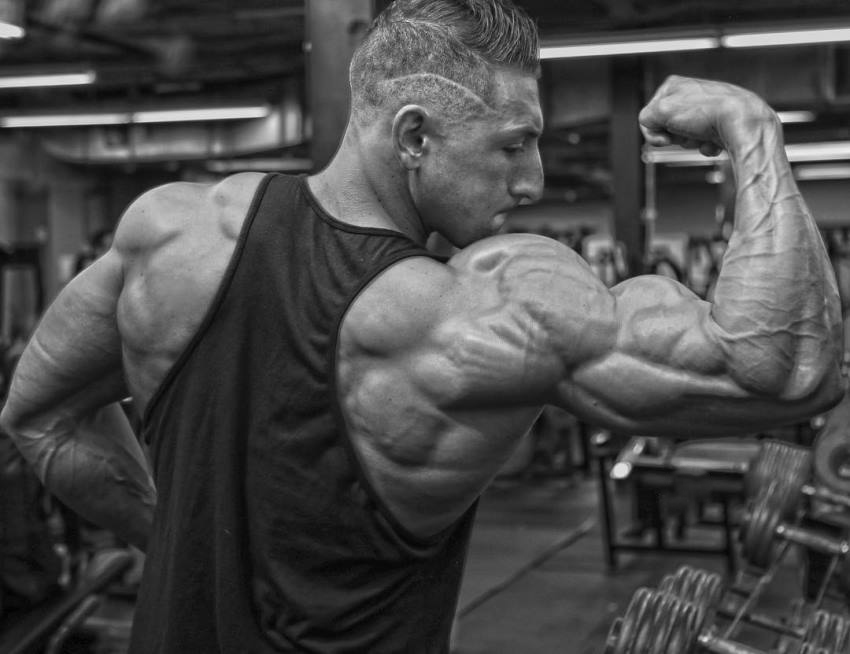 Anthony Scalza flexing his massive and ripped arm