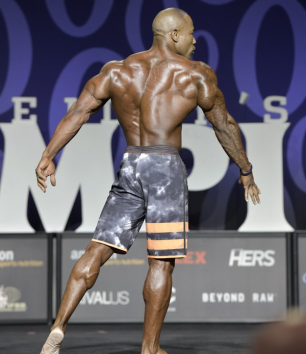 Antoine Williams showcasting his ripped back at the Mr. Olympia Men's Physique competition