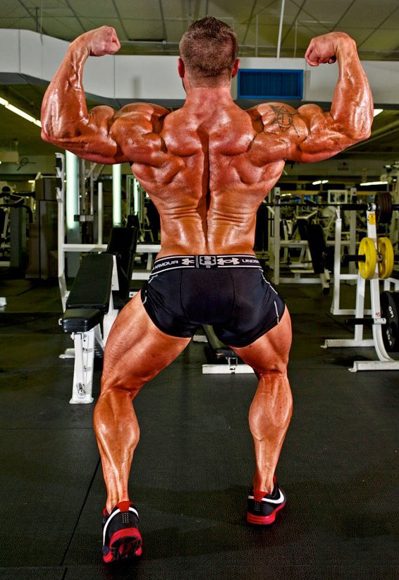 Brad Rowe showing off his back muscles.