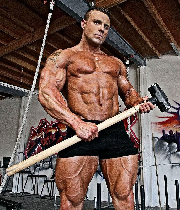 Brad Rowe holding a hammer in the gym.