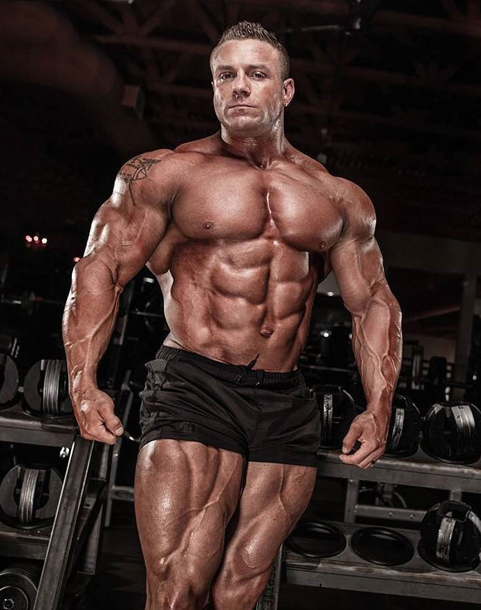 Brad Rowe showing off his physique in a photo shoot.