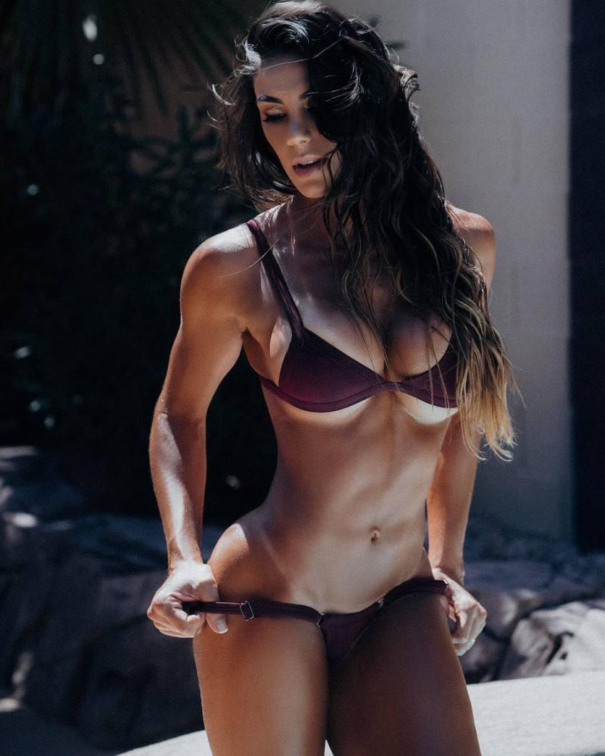 Carol Saraiva displaying her lean and fit figure in a black bikini
