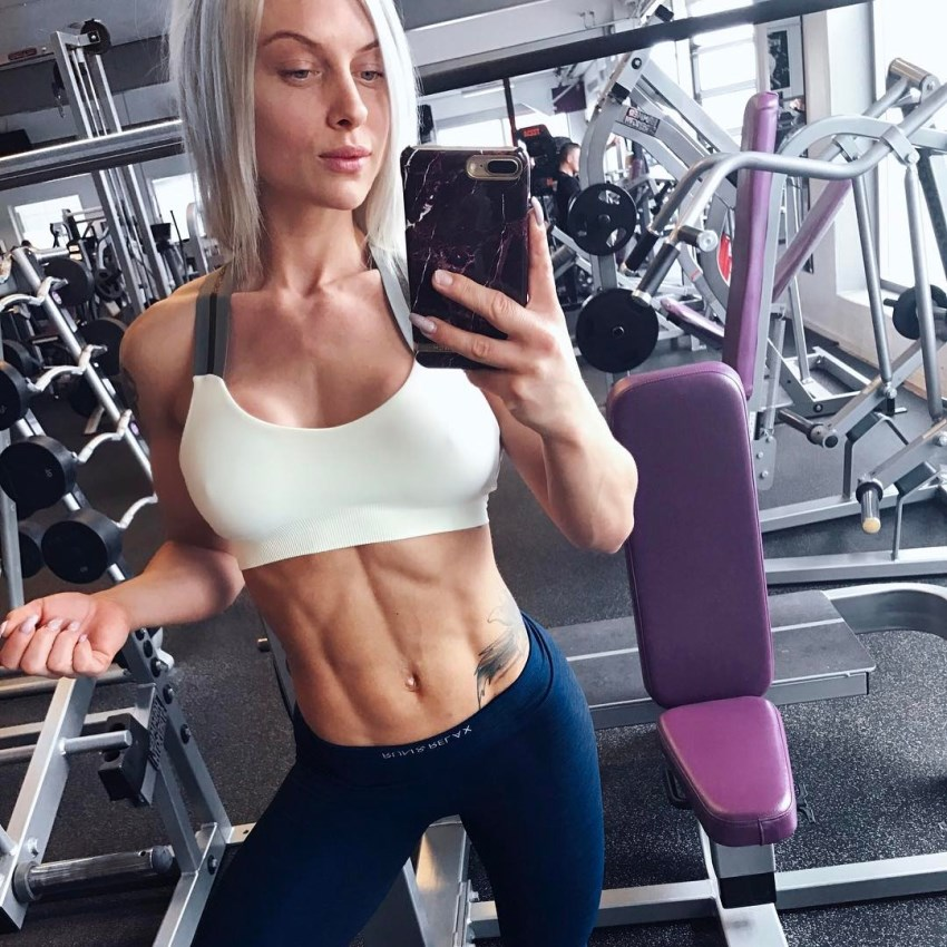Caroline Aspenskog taking a selfie of her lean and fit abs