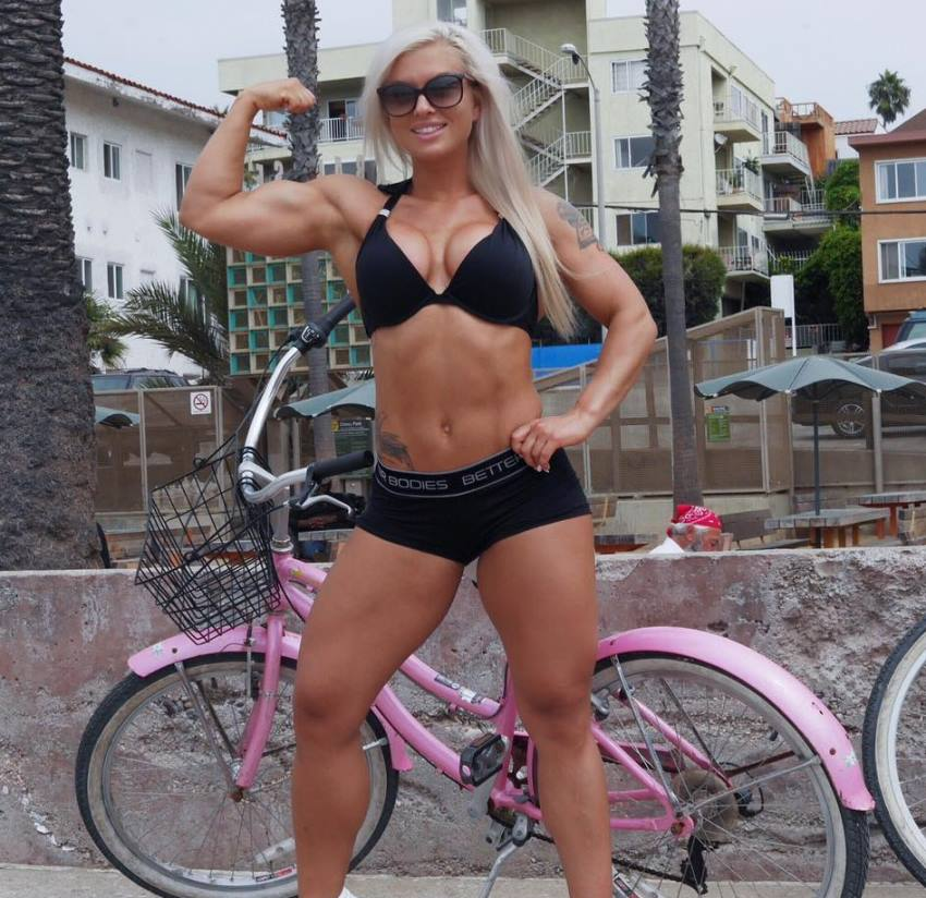 Caroline Aspenskog flexing her biceps looking lean and toned