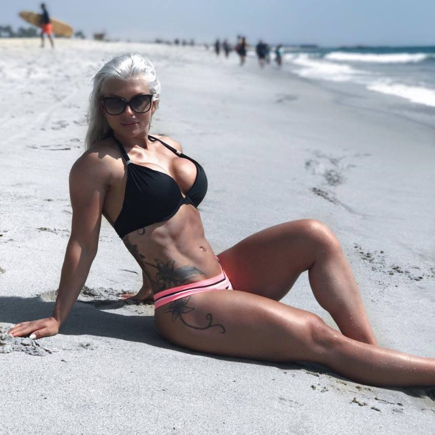 Caroline Aspenskog lying on the beach looking lean and fit