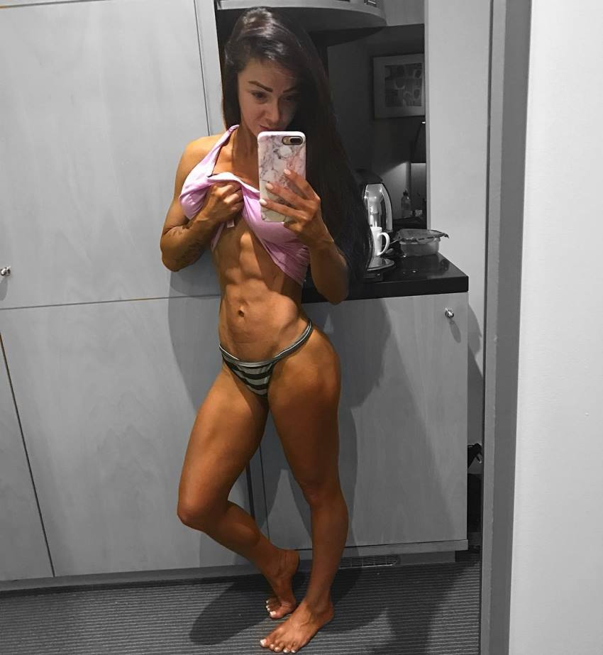 Caryn Nicole Paolini taking a selfie of her ripped abs pre-contest