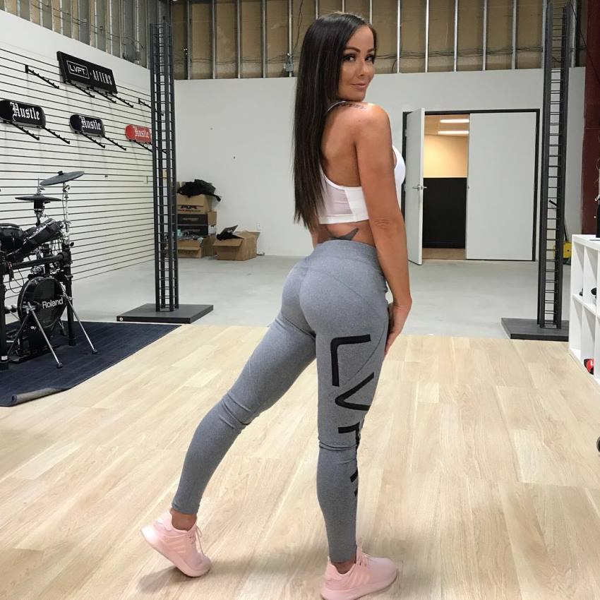 Caryn Nicole Paolini showcasting her glutes in grey leggings