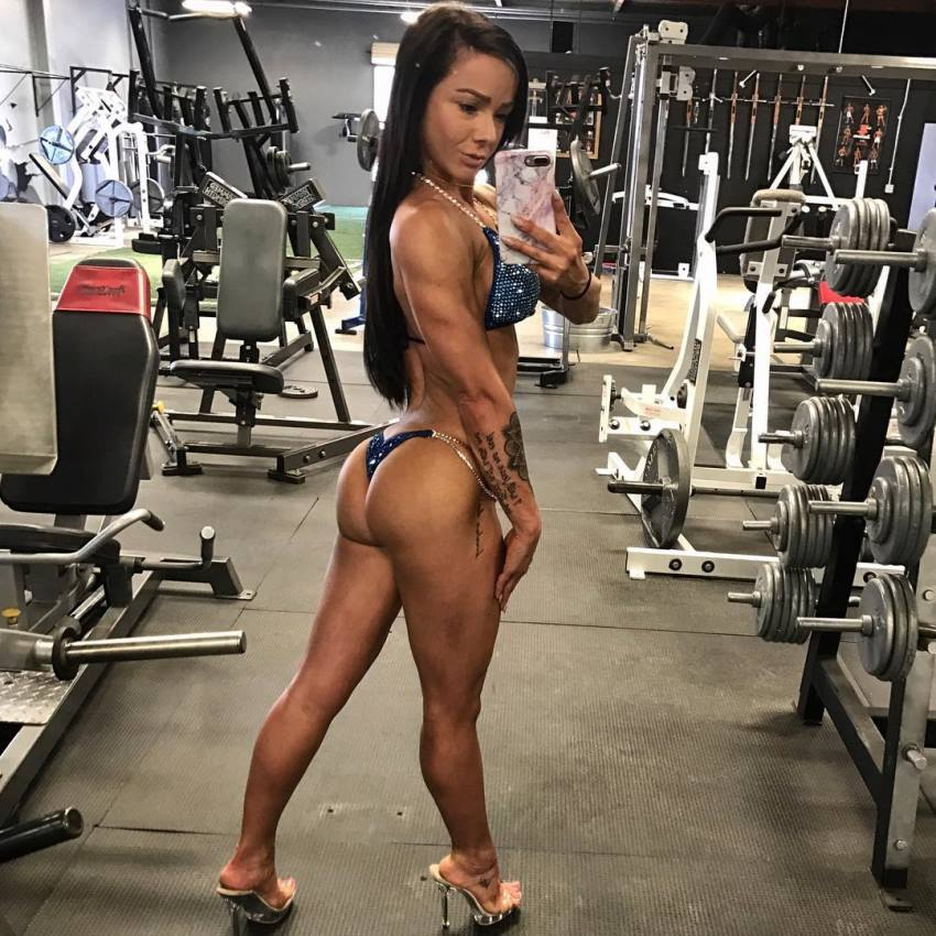 Caryn Nicole Paolini taking a selfie in bikini in a gym